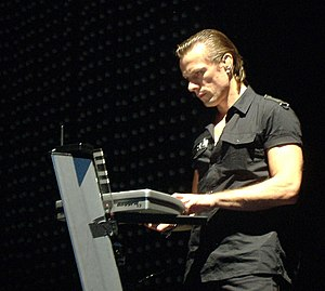 Larry Mullen Jr. - Mullen playing keyboards