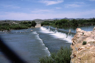 Drop structure - The spillway of Leasburg Diversion Dam, part of the Rio Grande Project, is an example of a vertical hard basin drop structure designed to dissipate energy.
