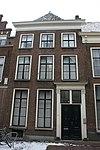 foto van Pand met gevel met rechte kroonlijst, dubbele deur met gesneden panelen en Empire omlijsting