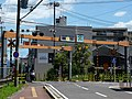 Level crossing near Takada Station.jpg
