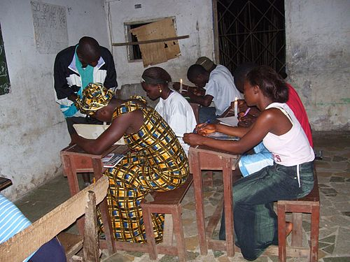 Students studying by candlelight in Bong County Liberian students.jpg