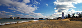 Fort Gratiot Light - A panorama of Lighthouse Beach. The Fort Gratiot Lighthouse and Blue Water Bridge can be seen.