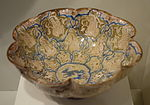 Lobed bowl with seated figures in compartments, Iran, Seljuk period, late 12th or early 13th century, earthenware with underglaze blue painting and overglaze luster - Cincinnati Art Museum - DSC04077.JPG