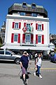 Lovely coloured hotel at Morges in bright sunshine and lots of walkers - panoramio.jpg
