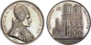 Coronation of Napoleon I - Commemorative coin with the image of Pius VII on the obverse and Notre Dame de Paris on the reverse. Note that the date on the reverse is given both according to the Gregorian and French Revolutionary calendars.