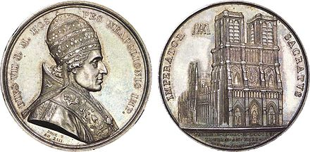 Commemorative coin with the image of Pius VII on the obverse and Notre Dame de Paris on the reverse. Note that the date on the reverse is given both according to the Gregorian and French Revolutionary calendars. Medaille celebrant le sacre de Napoleon Ier par Pie VII.jpg