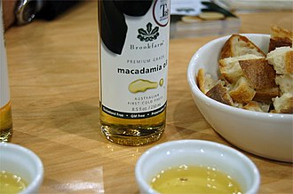 Macadamia oil - A bottle and dish of macadamia oil