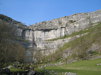 Craven Fault System - Malham Cove cliff face may have formed as a fault scarp on the Middle Craven Fault but has since retreated ca. 600 m