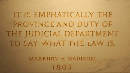 Inscription on the wall of the Supreme Court Building from Marbury v. Madison, in which Chief Justice John Marshall outlined the concept of judicial review Marbury v Madison John Marshall by Swatjester crop.jpg