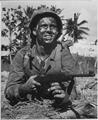 Marine awaits signal to go ahead in battle to recapture Guam from Japanese. - NARA - 520969.tif