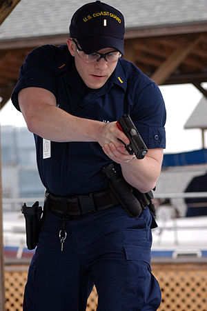 Maritime Law Enforcement Academy - A boarding officer student conducts a mock boarding