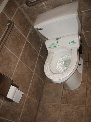 Automatic self-clean toilet seat - An automatic seat film replacer at a restaurant restroom, 2008