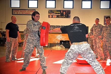 Members of the United States National Guard undergoing self-defense training. The force was created in 1903 as an organized militia. Missouri National Guard training.jpg