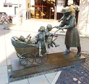 "Brand (Aachen) - Sculpture ""Kit and Caboodle"" (""Mit Kind und Kegle""), by Bonifatius Stirnberg"
