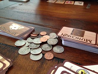 Munchkin (card game) - A game of Munchkin being played, with coins being used to denote levels.