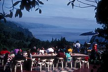 Diners around tables on the terrace of the Nepenthe restaurant can see many miles down the Big Sur coast.