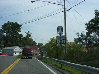 New York State Route 5 - Approaching Genesee Street on NY 174 northbound in Camillus. Until the Camillus Bypass was constructed, NY 5 followed Genesee Street and NY 174 ended at this junction.