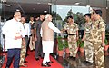 Narendra Modi meeting the security personnel as he leaves Mission Control Centre after witnessing the successful launch of PSLV-C23, at Sriharikota, in Andhra Pradesh. The ISRO Chairman, Dr. K Radhakrishnan is also seen.jpg