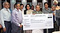 Narendra Singh Tomar receiving a dividend cheque of Rs.260.72 crore from the Chairman-cum-Managing Director NALCO, Shri Ansuman Das, in New Delhi. The Secretary, Ministry of Mines, Dr. Anup K. Pujari.jpg