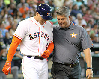 Athletic trainer - Athletic trainer Nate Lucero (right) evaluates Houston Astros baseball player George Springer after Springer was hit by a pitch in 2014
