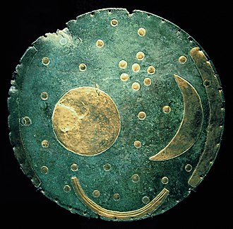 Pleiades - The Nebra sky disk, dated circa 1600 BC. The cluster of dots in the upper right portion of the disk is believed to be the Pleiades.