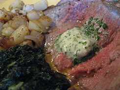 New York Strip with Beurre Maitre d'Hotel, potatoes and creamed spinach.jpg