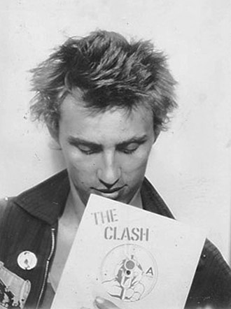 Nick Egan - Egan with a copy of The Clash's single 'White Man In Hammersmith Palais'