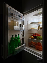 Open refrigerator with food at night.jpg