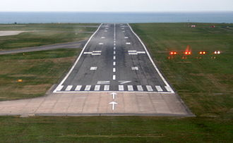 Precision approach path indicator - The PAPI can be seen to the right of the runway. The plane is slightly below the glideslope.
