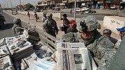 PSYOP Team Detachment 1080, 318th PSYOP Company distribute products in East Rashid, Baghdad, July 2007