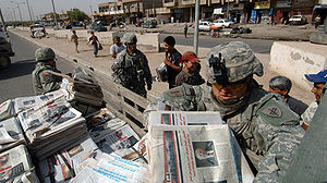 Psychological Operations (United States) - U.S. Army PSYOP soldiers with Detachment 1080, 318th Psychological Operations Company distribute newspaper products in the East Rashid region of Baghdad, Iraq, July 11, 2007.