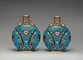Pair of round, flat bodied bottles MET DP-1687-025.jpg