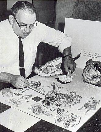 Pan Am Flight 214 - CAB engineer examines the badly damaged flight recorder of Pan Am Flight 214
