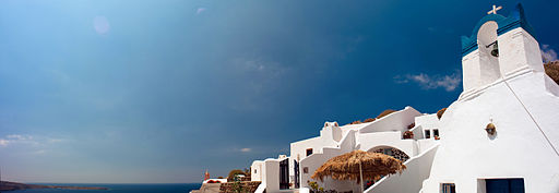 Panoramic skies over Oia Santorini island (Thira), Greece