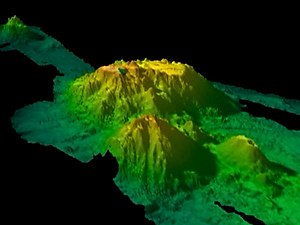 Cobb–Eickelberg Seamount chain - 3-D bathymetric  map of Patton Seamount, a Gulf of Alaska seamount, with two smaller seamounts in the foreground. Deep areas are blue, and shallow areas are red.