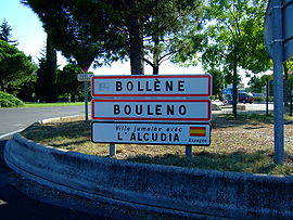 Entrance of Bollène. The second sign shows the town name in Provençal. The third one its twin town.
