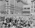 Photograph of large crowd gathered along a Washington street to welcome General Dwight D. Eisenhower. - NARA - 199116.tif