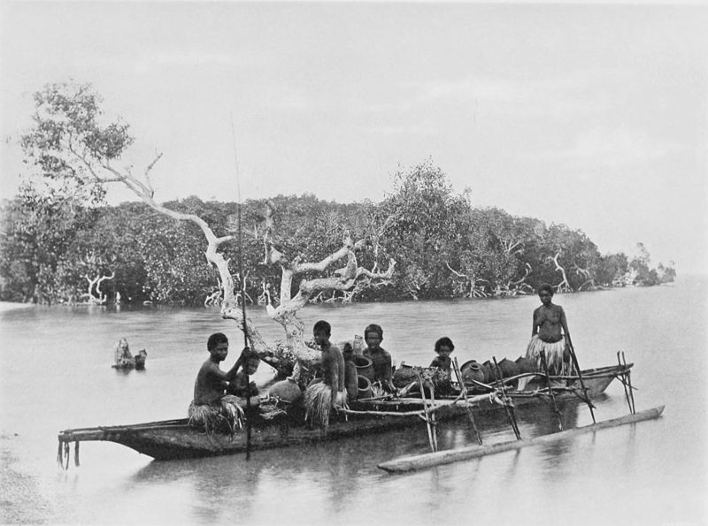 Black and white photograph of 4 native women and 2 children in an outrigger canoe with a number of empty spherical water-pots.
