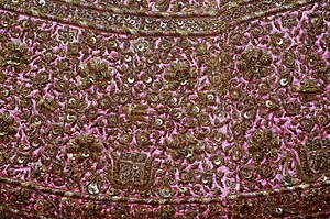 Pink dress with embroidery, detail, Crafts Museum, New Delhi.jpg