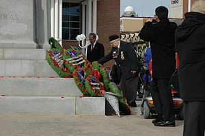 Brampton City Hall - Veteran placing a poppy at the Brampton cenotaph at Ken Whillan's Square