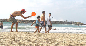 Matkot - Player poised to hit the ball