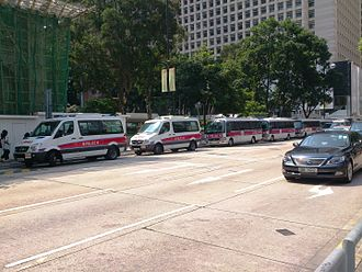 Hong Kong Police Force - Police cars on a road in Central
