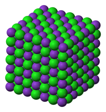 The crystal lattice structure of potassium chloride (KCl), a salt which is formed due to the attraction of K cations and Cl anions. Note how the overall charge of the ionic compound is zero. Potassium-chloride-3D-ionic.png