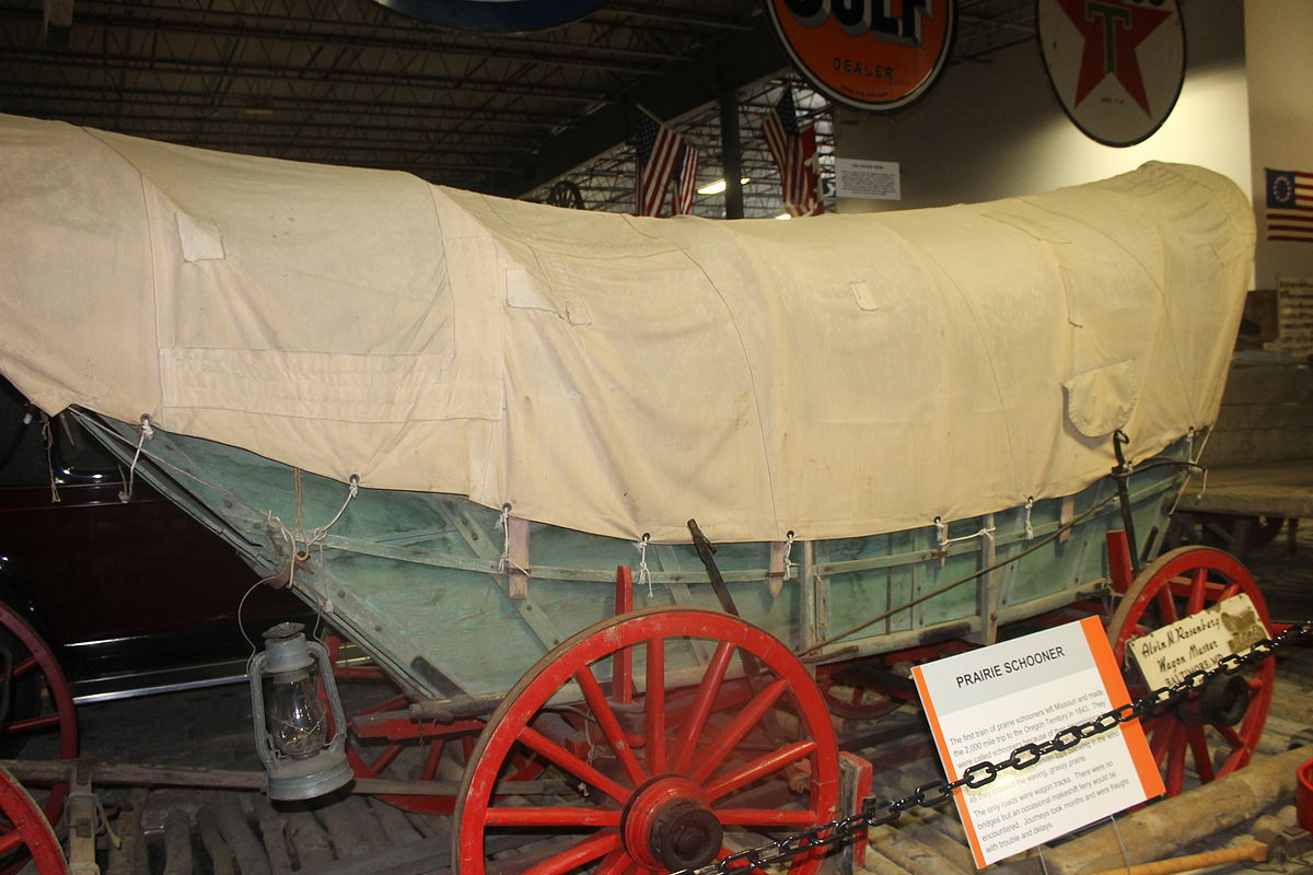 the covered wagon Define covered wagon: a wagon with a canvas top supported by bowed strips of wood or metal.