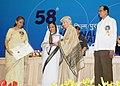 Pratibha Devisingh Patil presenting the Swarna Kamal Award to Smt. Vijaya Mulay for Best Book on Cinema (English From Rajahs and Yogis to Gandhi and Beyond), at the 58th National Film Awards function.jpg