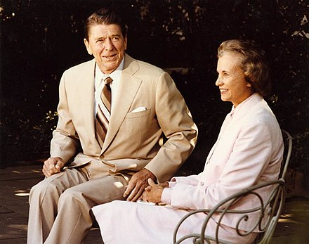 Supreme Court Justice-nominee Sandra Day O'Connor talks with President Ronald Reagan outside the White House, July 15, 1981. Serving from her appointment in 1981 by Ronald Reagan until her retirement in 2006. She was the first woman to serve as a Justice of the Supreme Court of the United States. President Reagan and Sandra Day O'Connor.jpg