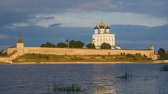 Pskov Krom - The Krom (or Kremlin) in Pskov, with the Velikaya River in the foreground and the Trinity Cathedral in the background