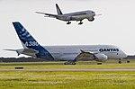 Qantas A380 (F-WWOW) holding short for Singapore Airlines B777.jpg