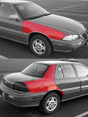 Quarter panel - 1990's Pontiac Grand Am sedan fender (top) and quarter panel (bottom)