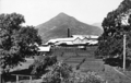 Queensland State Archives 1222 Mulgrave Central Sugar Mill Gordonvale Pyramid Mountain in the background near Cairns c 1935.png